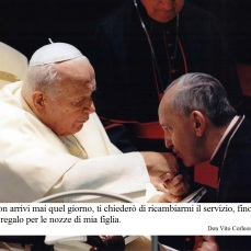 In this undated picture released by journalist Sergio Rubin, Jorge Mario Bergoglio, Archbishop of Buenos Aires, right, kisses the hand of late Pope John Paul II during a ceremony at the Vatican. Bergoglio, who took the name of Pope Francis, was elected on Wednesday, March 13, 2013 the 266th pontiff of the Roman Catholic Church. (AP Photo/Courtesy of Sergio Rubin, ho)